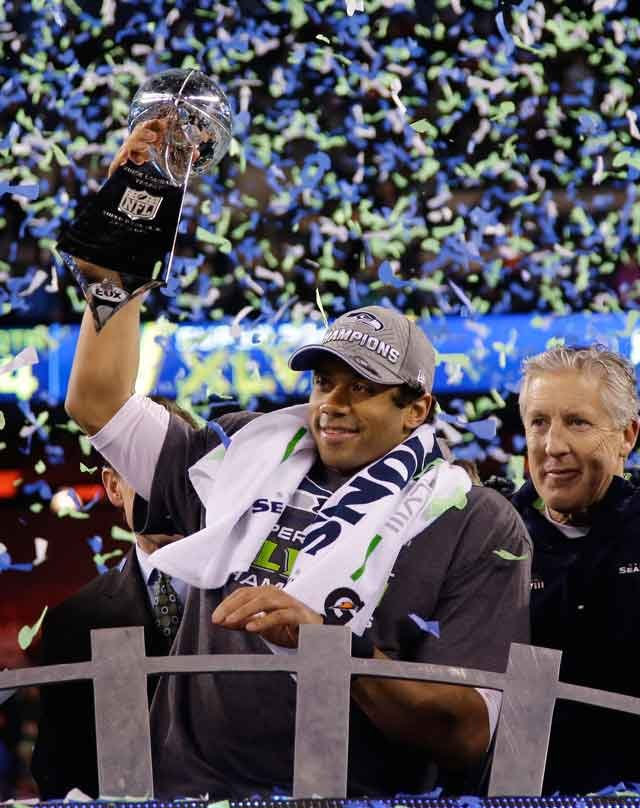 Seattle Seahawks Russell Wilson Holds The Vince Lombardi Trophy After NFL Super Bowl XLVIII
