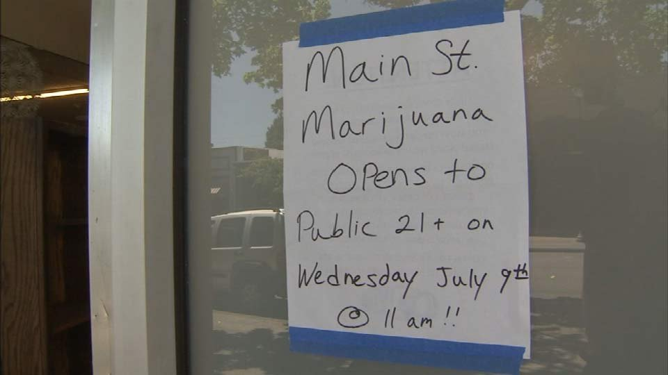 A sign announces Main Street Marijuana's opening