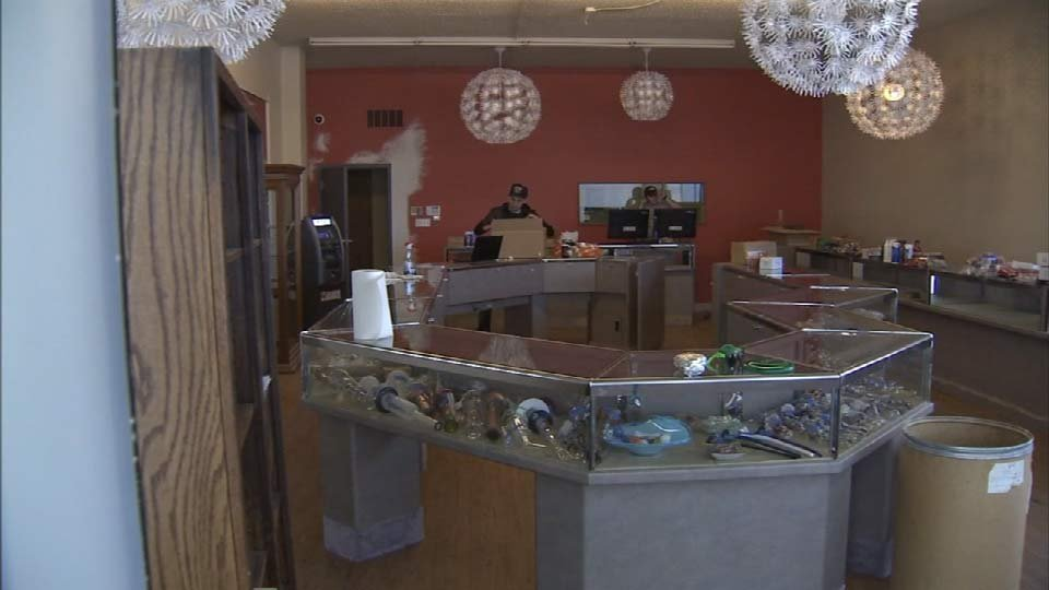 A worker at Main Street Marijuana gets the store ready for opening