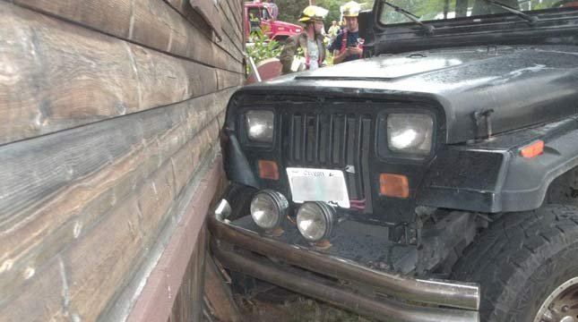 Police said a 3-year-old boy knocked a Jeep out of gear and crashed into a nearby home. Photo: Myrtle Creek Police Dept.