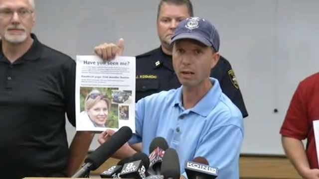 Kallen Huston fought back tears as he answered questions about the search for his wife, Jennifer Huston, on Monday.