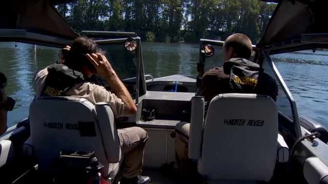 Search crews looked up and down the Willamette River for any sign of Huston's SUV.