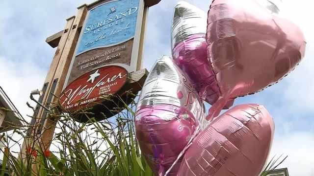 Balloons were left at a makeshift memorial outside the Surfsand Resort in Cannon Beach where a 2-year-old girl was found dead in what has been ruled a homicide.