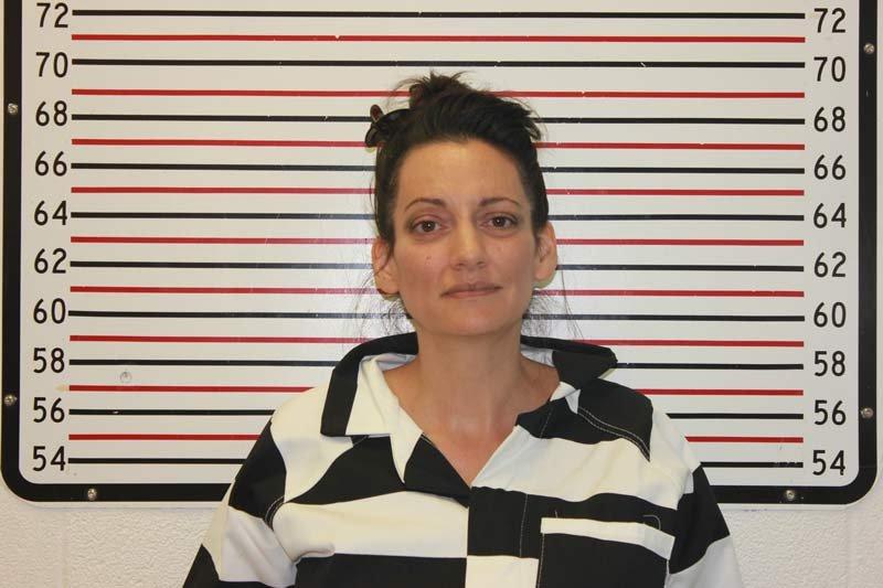 The girls' mother, Jessica Smith, was arrested in a heavily forested area 15 miles from the Cannon Beach crime scene.
