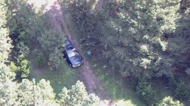 Air 12 was over the scene where Jennifer Huston's SUV was found on a remote road near Sheridan on Tuesday. Her body was found a short distance away.