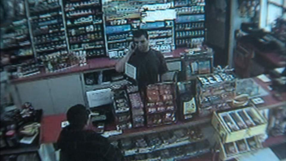 Surveillance video of the suspect attempting to rob the convenience store