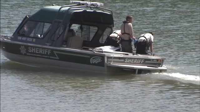 Search crews scoured Hagg Lake after an unconscious 3-year-old boy was pulled from the water Monday evening.