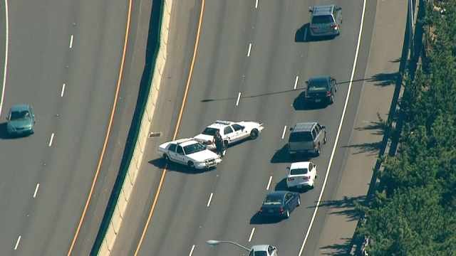 Police: Carjacking suspect waving gun on I-84 shot by officer