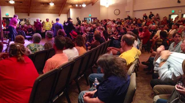 A standing-room only crowd attended a community meeting in Estacada regarding the 36 Pit Fire on Sept. 16.