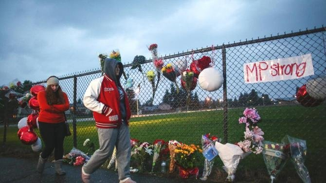 (AP Photo/seattlepi.com, Joshua Trujillo). A memorial grows Saturday Oct. 25, 2014 at the entrance to Marysville Pilchuck High School the day after a shooting in the school cafeteria left two dead and four wounded.