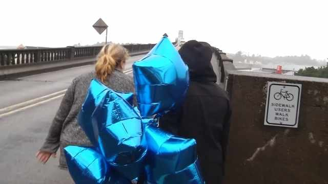 People brought balloons and flowers to the bridge in honor of London McCabe on Tuesday.