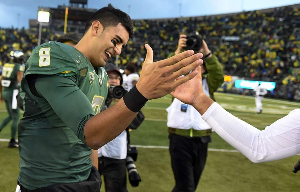 Oregon quarterback Marcus Mariota not only has his team in position for the College Football Playoffs. He's the favorite to win the Heisman Trophy.