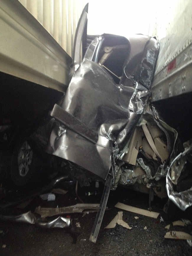 Man Survives Car Crash Between Two Semis