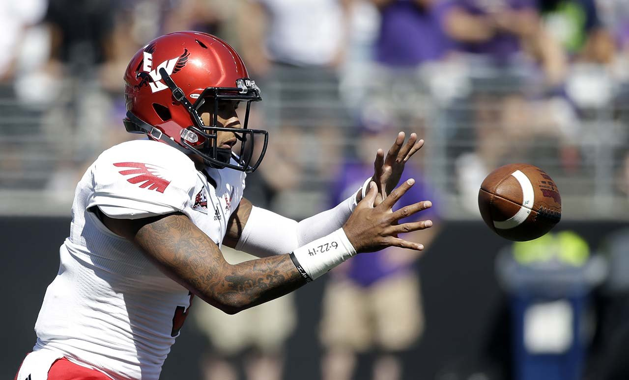 Eastern Washington quarterback Vernon Adams Jr. takes a snap against Washington in 2014. (AP Photo)