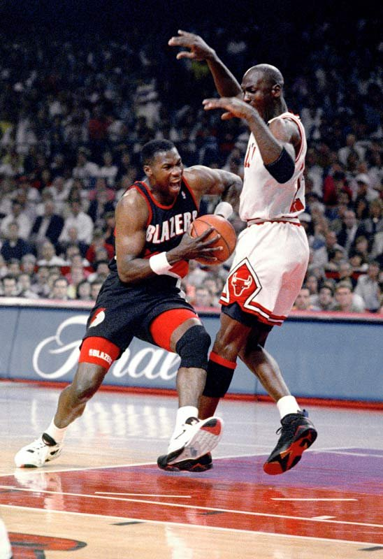 The Chicago Bulls' Michael Jordan tries to hold off the Portland Trail Blazers' Jerome Kersey during first quarter of Game 6 in the NBA Finals in Chicago, Sunday, June 14, 1992. (AP Photo/Fred Jewell)