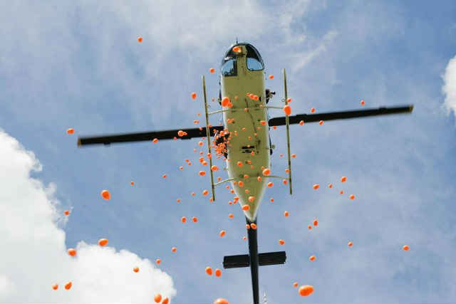 A helicopter drops 20,000 eggs at Brentwood Park. (Photos courtesy: Brian Becker/Hopecity Church)