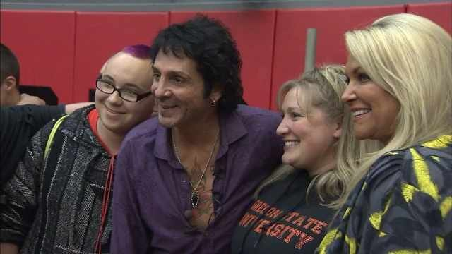 Deen Castronovo and his wife posing for photos at South Albany High School