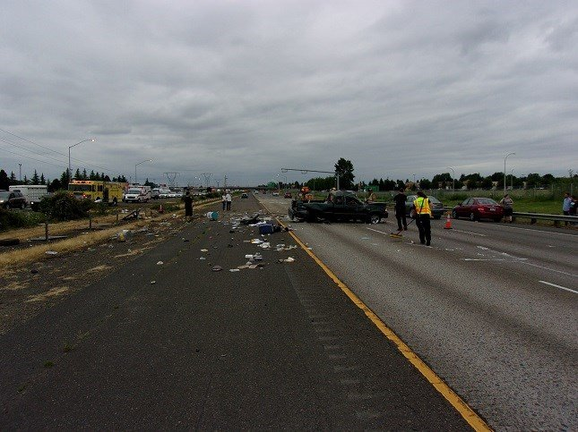 Truck rolls into oncoming traffic on I-5 near Woodburn - Portland