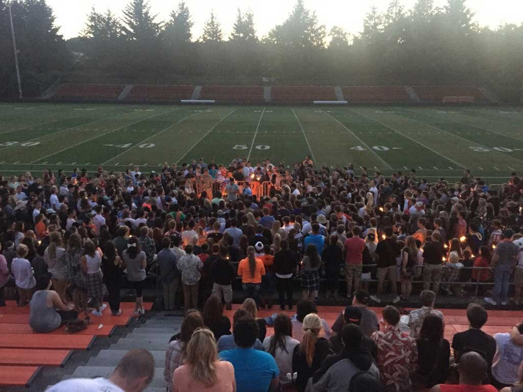 Friends and family gather for a candlelight vigil at Sprague H.S. Monday