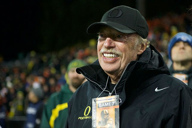 Phil Knight, co-founder and chairman of Nike, Inc., watches Oregon play Oregon State from the sidelines during an NCAA college football game in Corvallis, Or., Saturday, Nov. 15, 2014. (AP Photo/Troy Wayrynen)