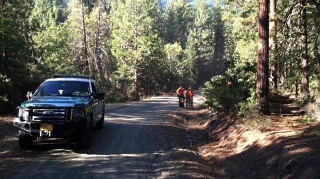 Detectives searching the area near Lennie Ames' camp in 2013. (Photo: Jackson County Sheriff's Office)