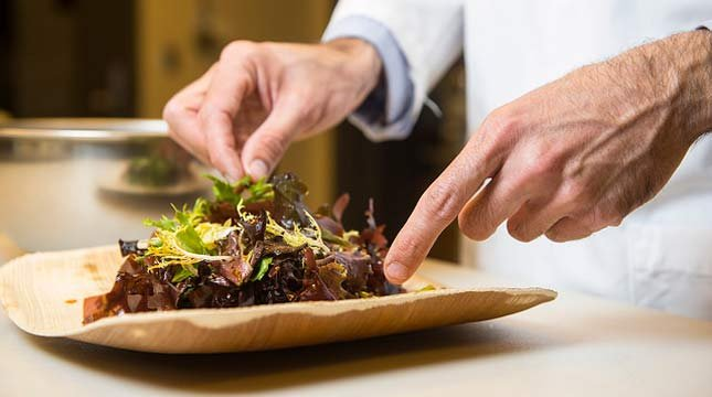 Jason Ball, research chef at the Food Innovation Center, Portland, Oregon prepares dishes made with the ingredient dulse. (Photo by Stephen Ward, OSU Extension and Experiment Station Communications)