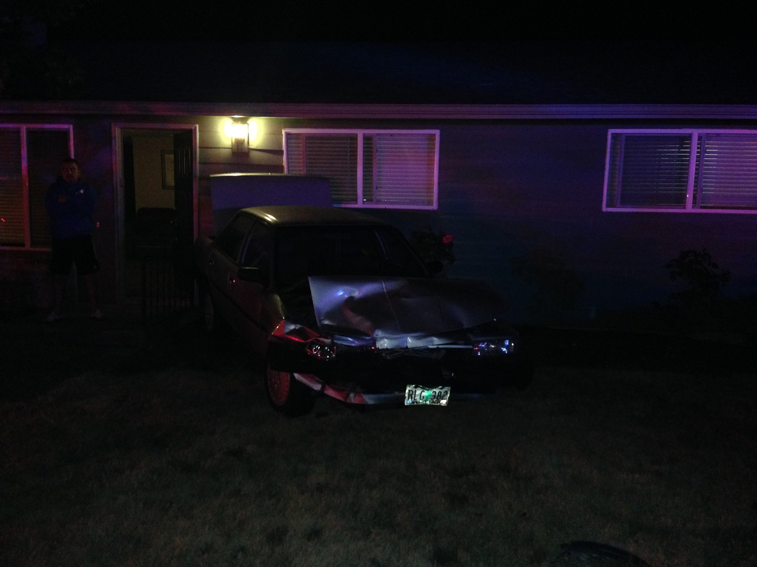 Parked car pushed into home