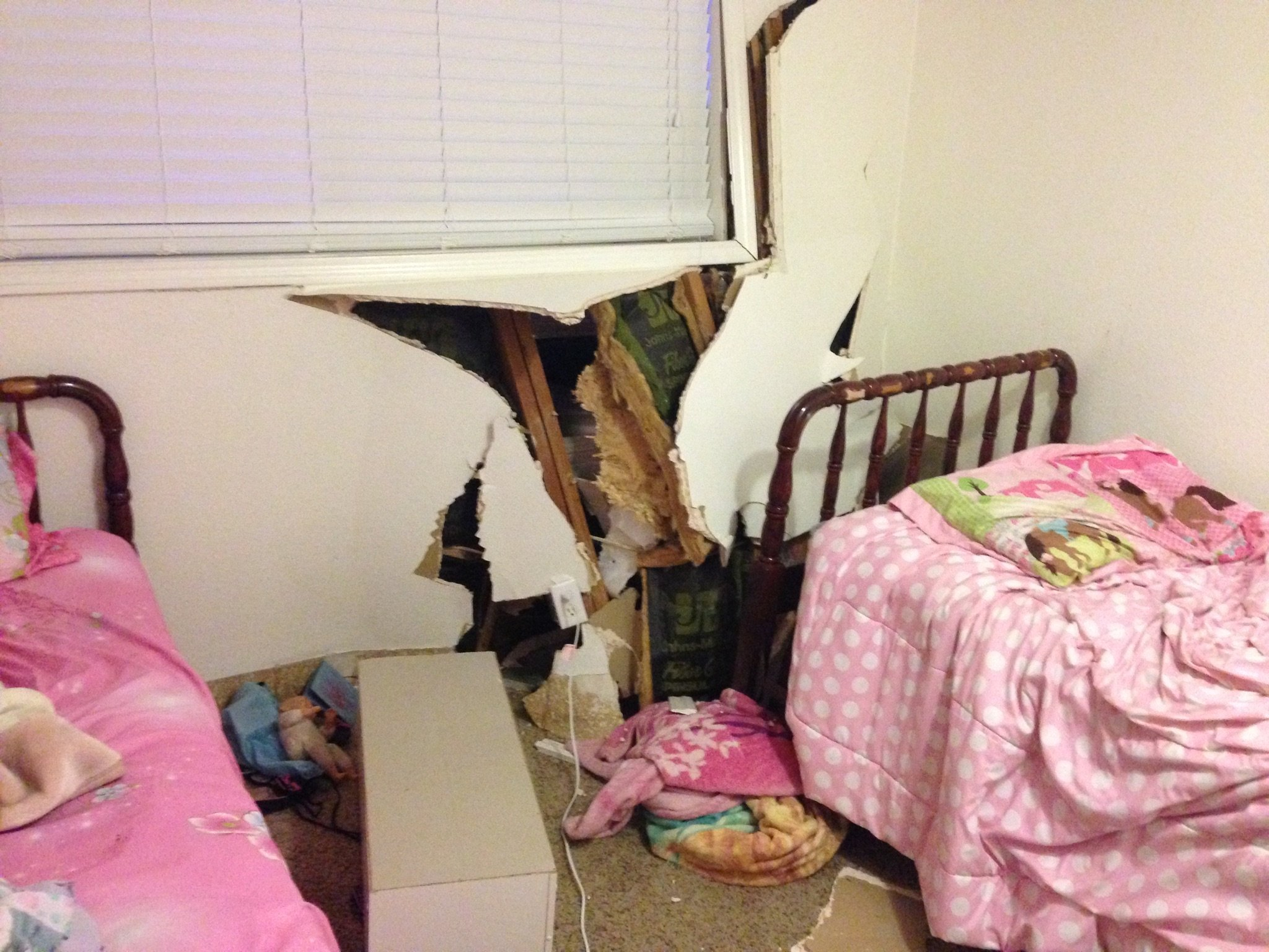 Car ends up in little girls' room