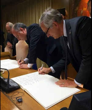 Mayor Hales signing a climate change document at the Vatican. (Photos: Mayor Charlie Hales twitter)