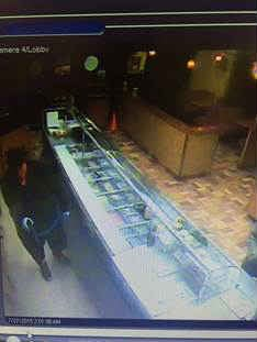 Surveillance photo of the second suspect.
