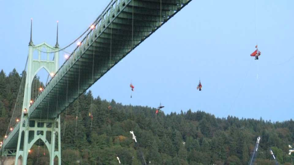 13 protesters rappelled over the side of the St. Johns Bridge Wednesday morning