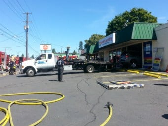 Car crashes through Plaid Pantry