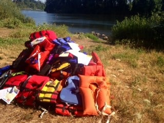 The pile of life jackets already collected.