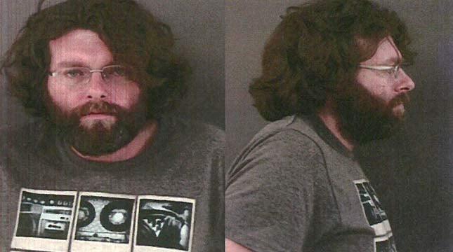 John Cook, jail booking photo