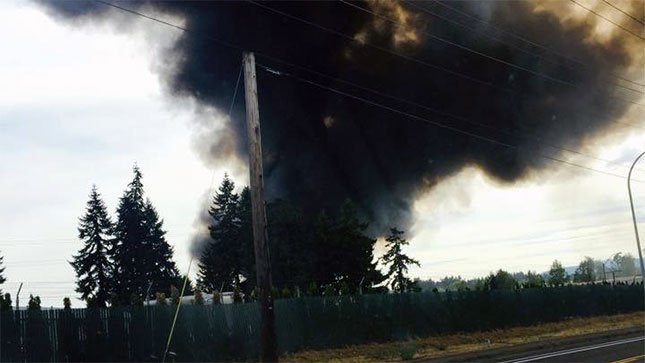 Smoke billowed from a train trestle fire burning in Sherwood Monday. (Photo: Daniel Andrew Hernandez-Krieger)