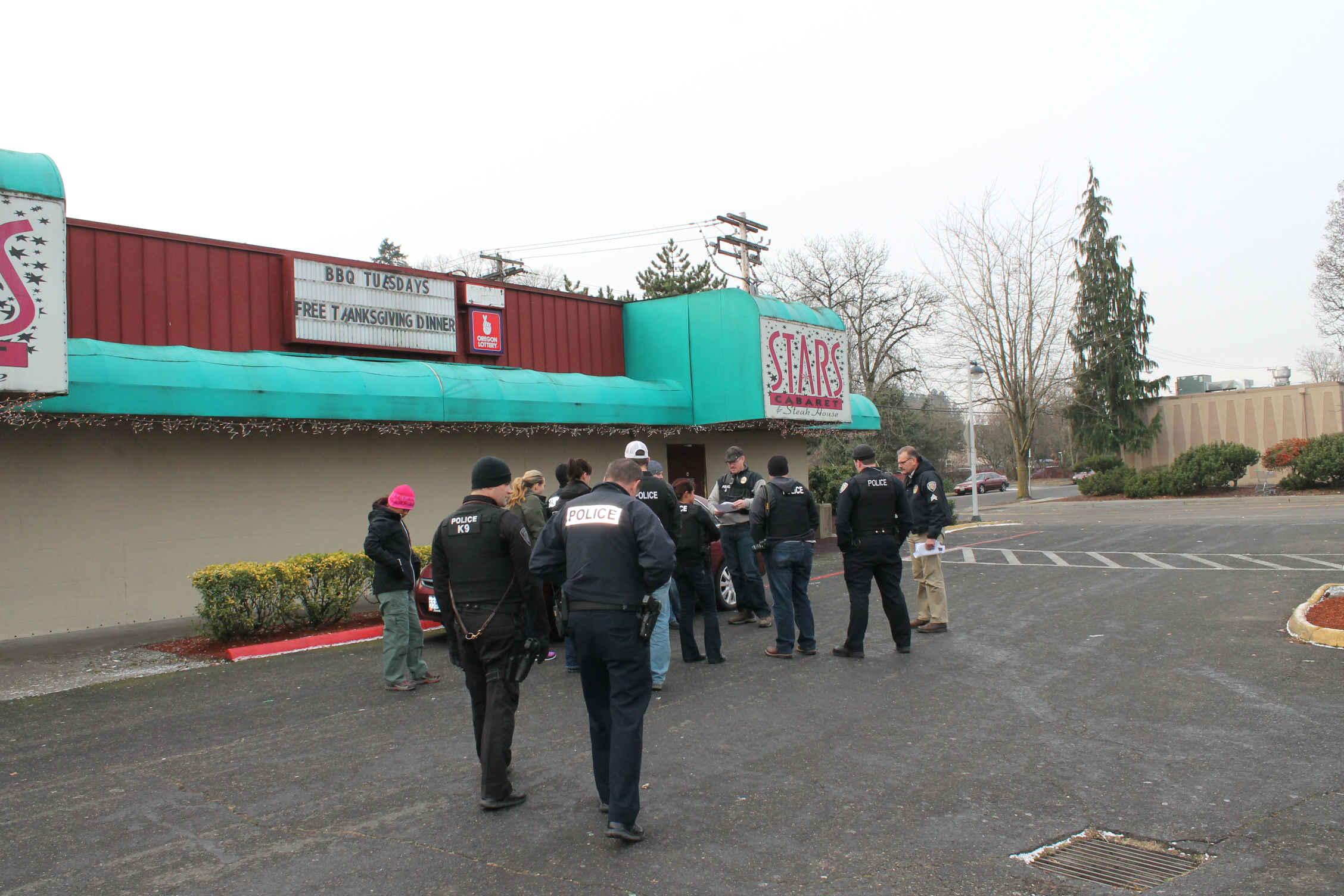 Police serving a warrant at Stars Cabaret in Beaverton in December 2013 (file image)