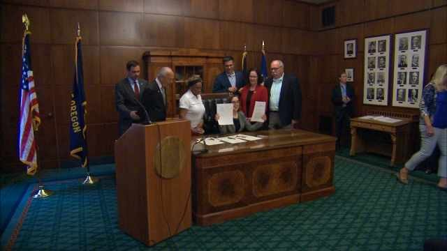 Governor Kate Brown signs new bill that will create Trail Blazer license plates.