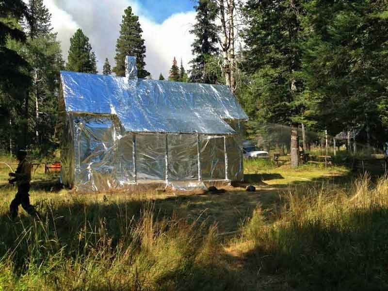 Historic Cabin Wrapped In 39 Foil 39 For Fire Protection