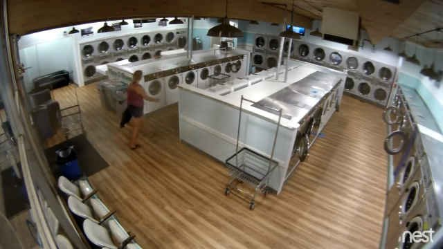 Surveillance photo of woman who stole the clothes.