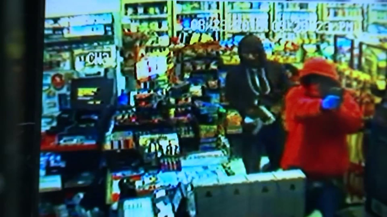 Surveillance video of armed robbery suspects at Stop and Go Market.