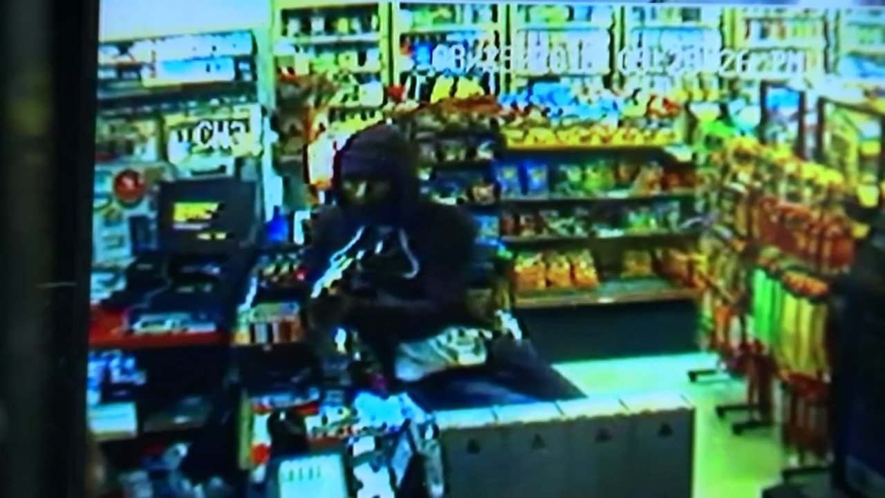 Surveillance video of armed robbery suspect at Stop n' Go Market.