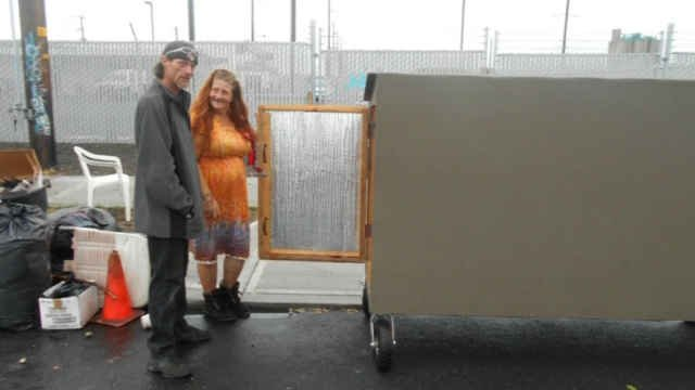 Jerad Nichols and Donna, who received a portable home on Monday.