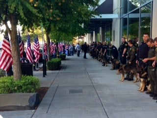 The Patriot Guard and K9 teams lining the sidewalk outside Vancouver Police K9 Ike's memorial service.
