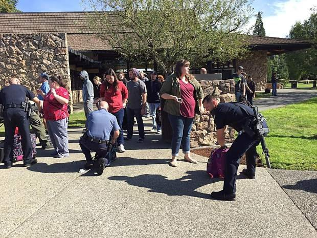 Police search students' bags (Photo: Roseburg News-Review)