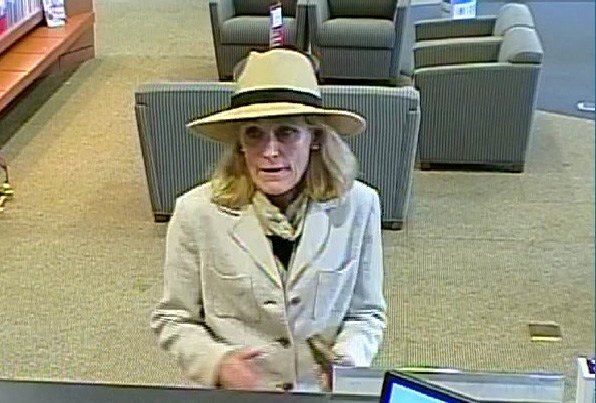 Wanted purse theft suspect. Surveillance image from Vancouver PD.