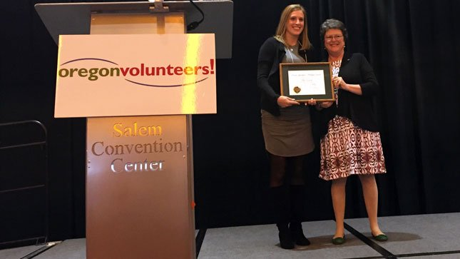 CCA Volunter Melissa DiGrigorio receiving the Governor's Volunteer Award from Secretary of State Jeanne Atkins.
