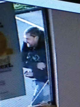 Surveillance photo of suspect. (Photo: Clackamas Co. Sheriff's Office)