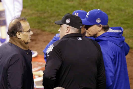 Executive Vice President for Baseball Operations Joe Torre talks to New York Mets manager Terry Collins and Kansas City Royals manager Ned Yost during a television technical interruption during the fourth inning of Game 1 of the World Series.