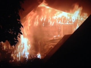 Flames tear through the home on NE 69th Ave.