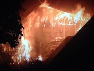 Flames tear through the home on NE 69th Ave.